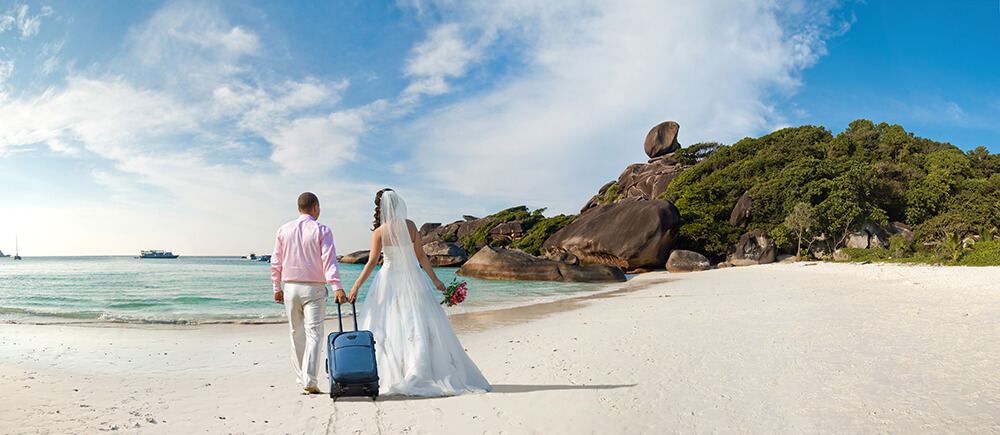 You're going to be spending a ton of money on your wedding; use that spend to leverage a free honeymoon.