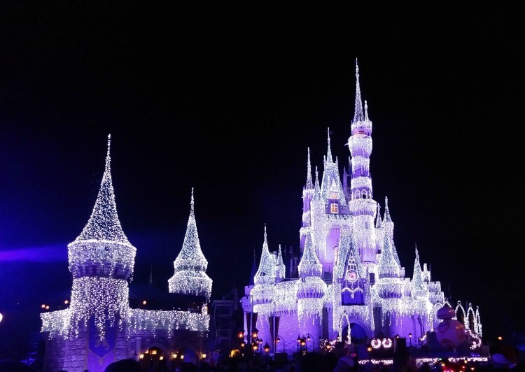 The Disney castle in Orlando, covered with icicle lights for the holiday season.