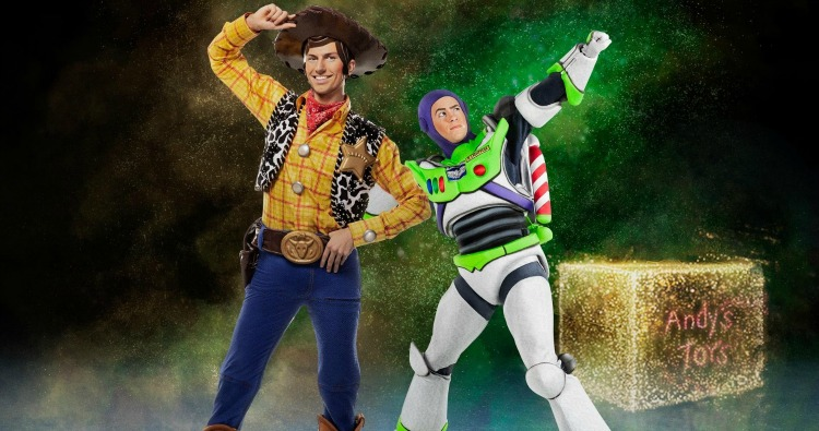 Woody and Buzz Lightyear from Disney's Toy Story link arms and pose on ice skates in the dark with backlit hay bales behind them.