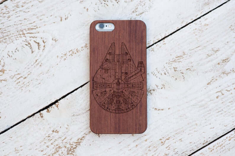 wooden iphone case with millennium falcon from star wars etched on the back